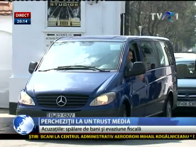 Percheziții la un trust media