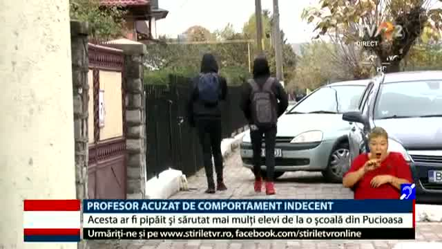 Profesor acuzat de comportament indecent