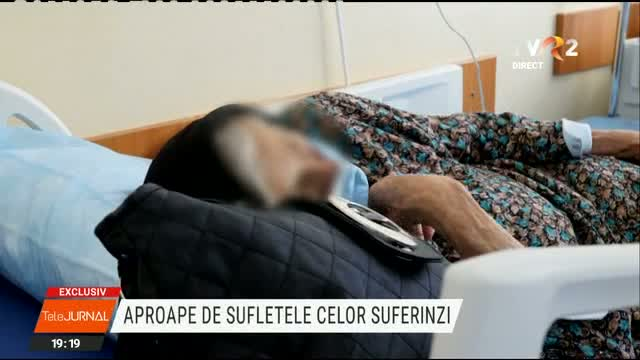 Preot care alina suferinzii in spital